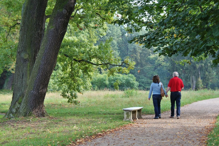 how to lose 15 pounds in a month by walking couple down tree lined road