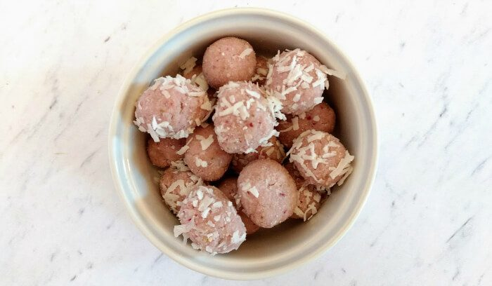 low carb energy bites coated with coconut flakes