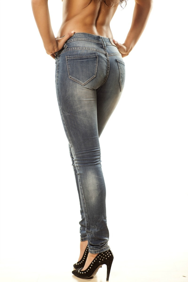 woman in jeans showing results of best butt exercises