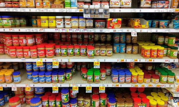 keto nut butter on several shelves in a grocery store aisle