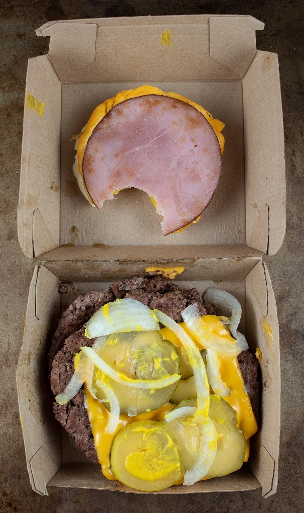 keto mcdonald's box with egg mcmuffin and quarter pounder with cheese inside