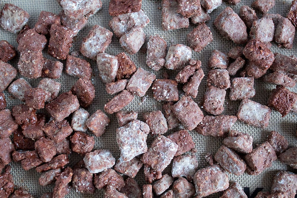 overhead view of keto puppy chow spread out on a baking sheet