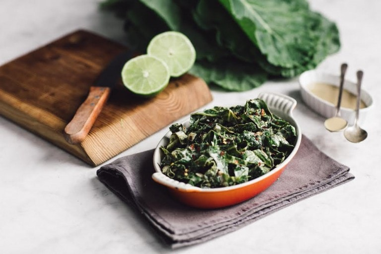 keto tahini collard greens in a small red bowl