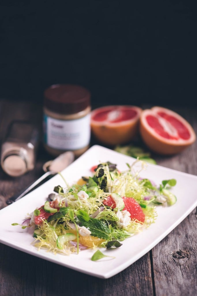 keto tahini vinaigrette dressing on salad on white plate