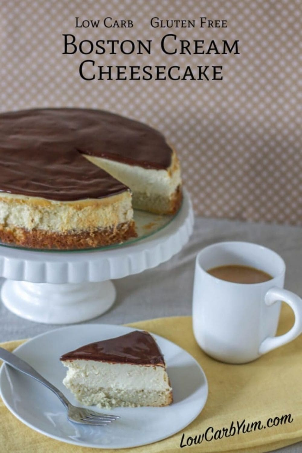 one slice of boston cream keto cheesecake on a plate with a fork next it and a coffee and a boston cream keto cheesecake sitting on an elevated platter with one piece missing