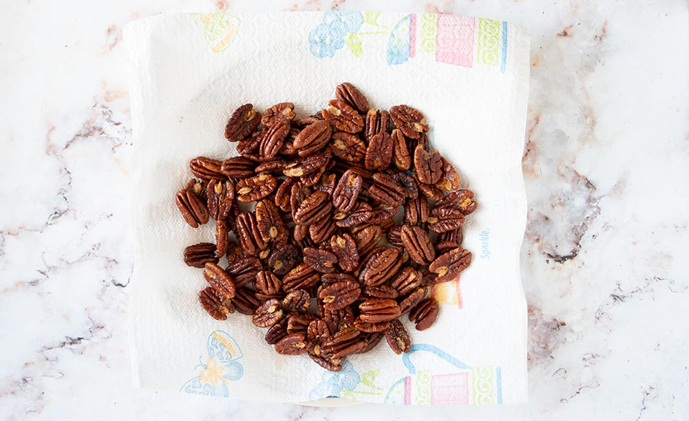 chocolate covered pecans toasted on a paper towel
