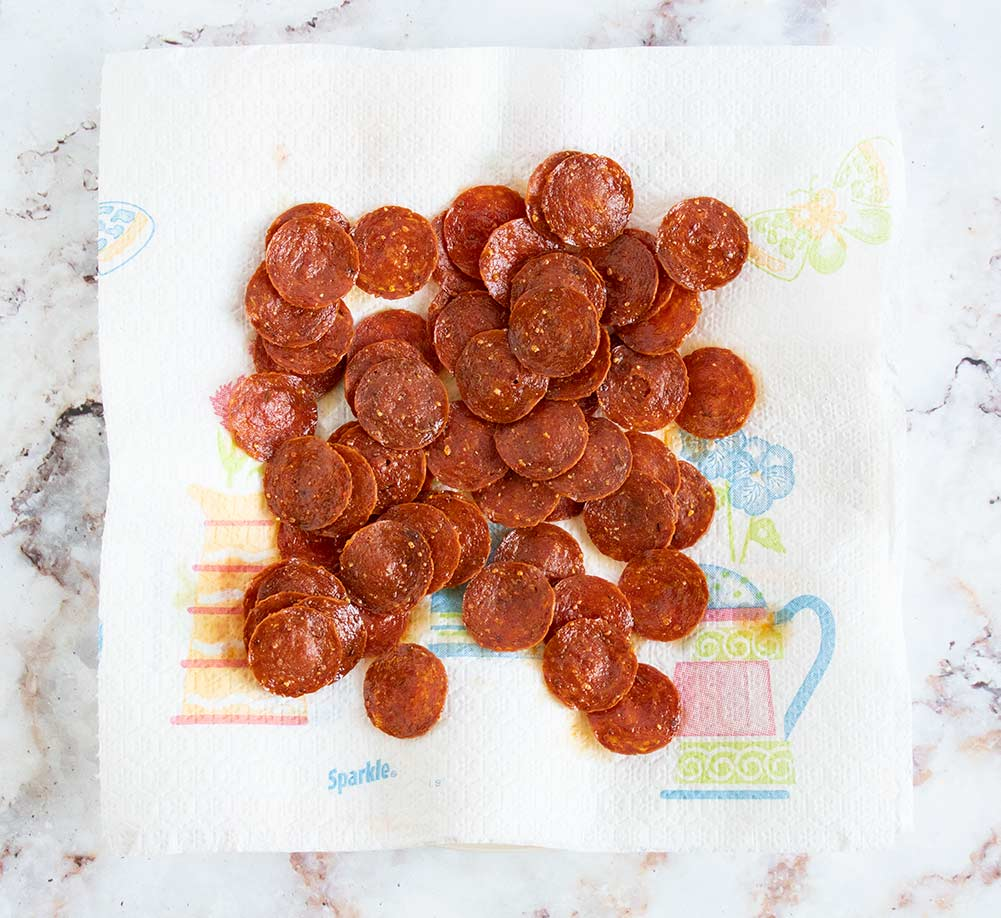 keto pepperoni chips on a paper towel with grease