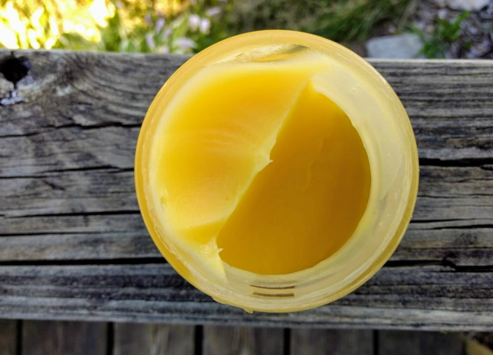 ghee used in keto condensed milk on a porch railing
