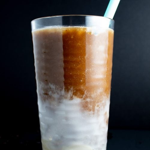 keto iced coffee closeup of glass with blue straw