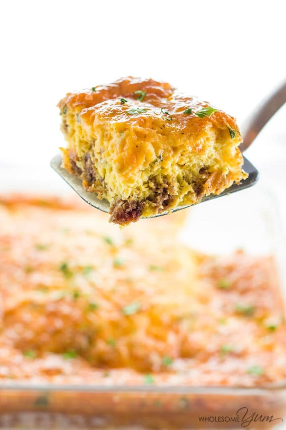 Keto Breakfast egg casserole with one square being served on a spatula