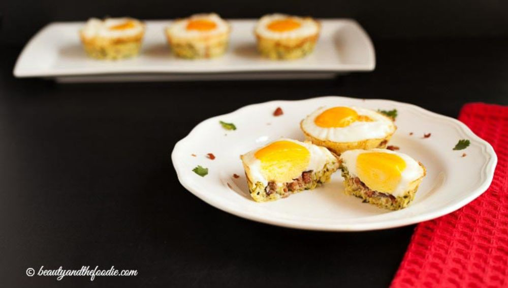 Keto Breakfast served on two plates with three egg zuchinni nests on each