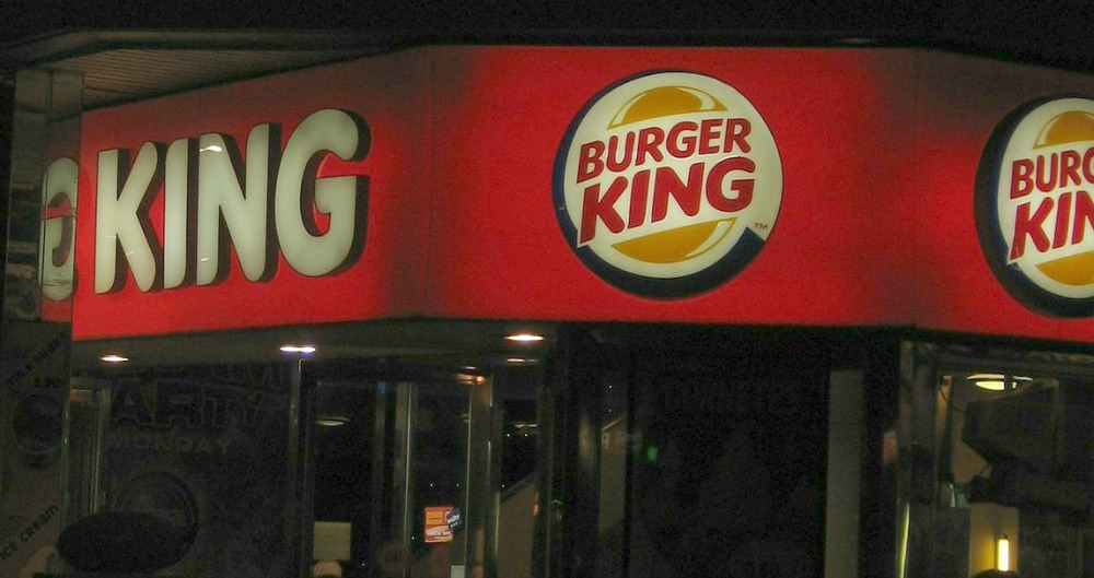 keto burger king restaurant outside in the dark with lit up logo