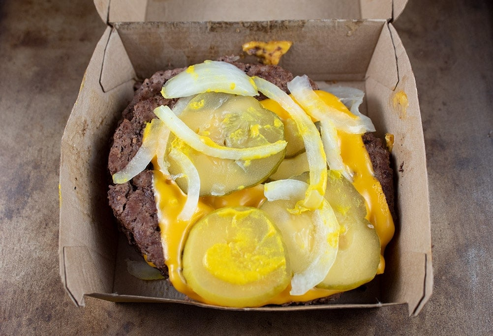 Keto Fast Food McDonald's Big Mac burger with cheese, pickles, onions, and mustard