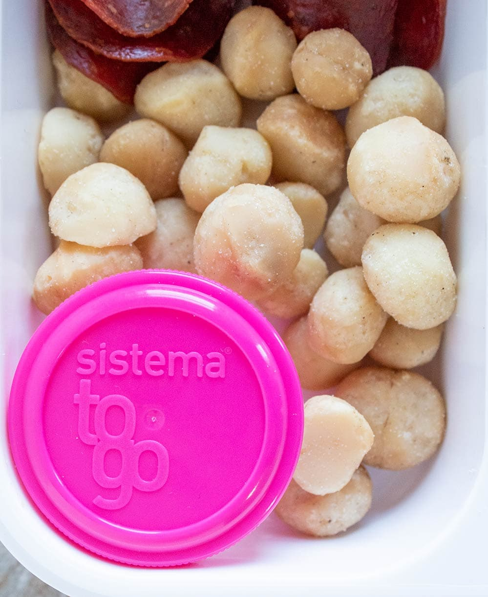 closeup of keto bistro box with pink container and macadamia nuts