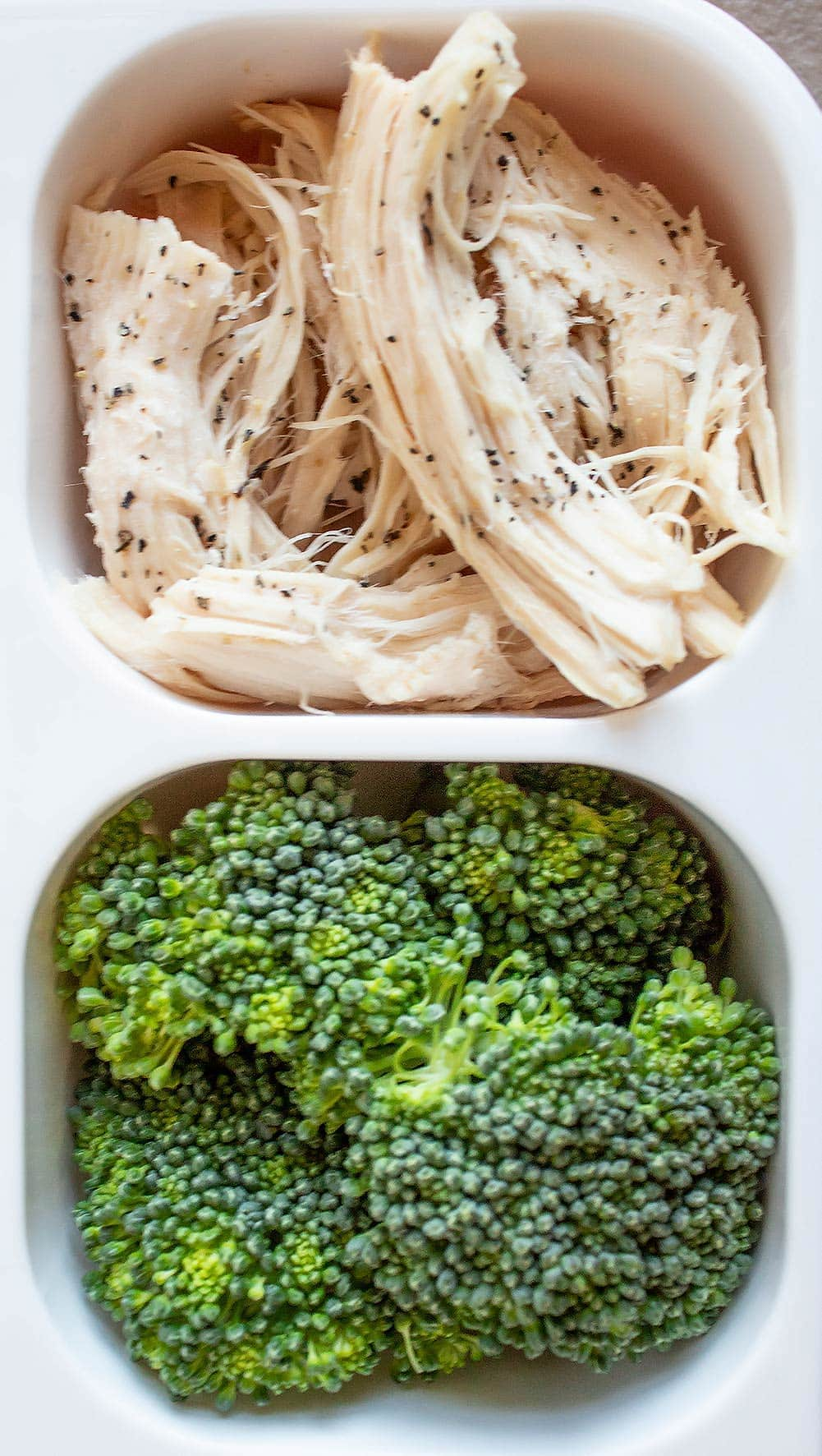 keto bistro box with fresh broccoli and shredded chicken with salt and pepper