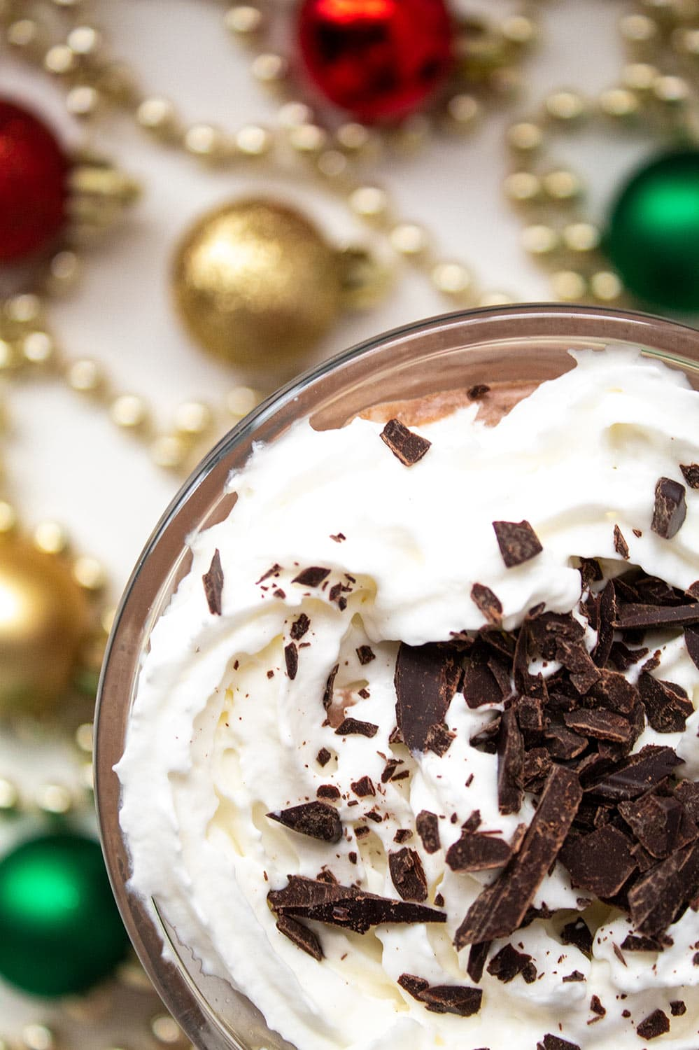 closeup overhead view of keto peppermint mocha with christmas decor on ground