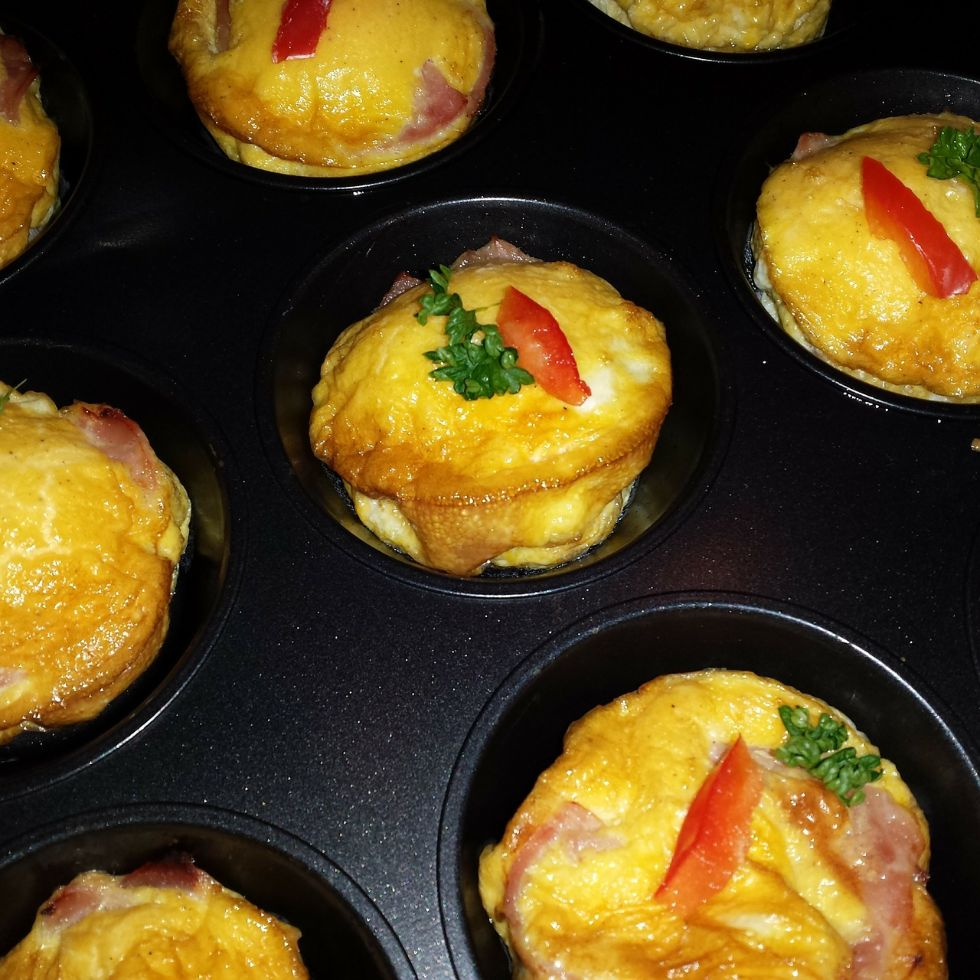 keto starbucks egg bites in a muffin tin fully baked with garnish on top