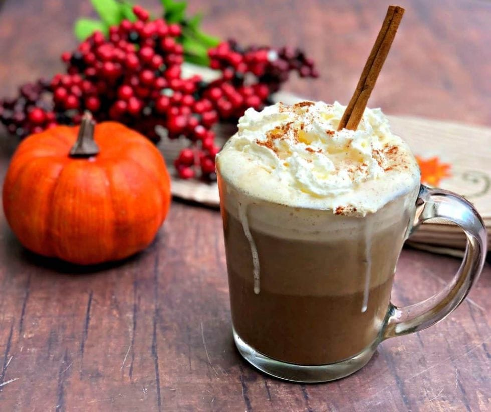 keto starbucks pumpkin spice latte with a pumpkin in the background