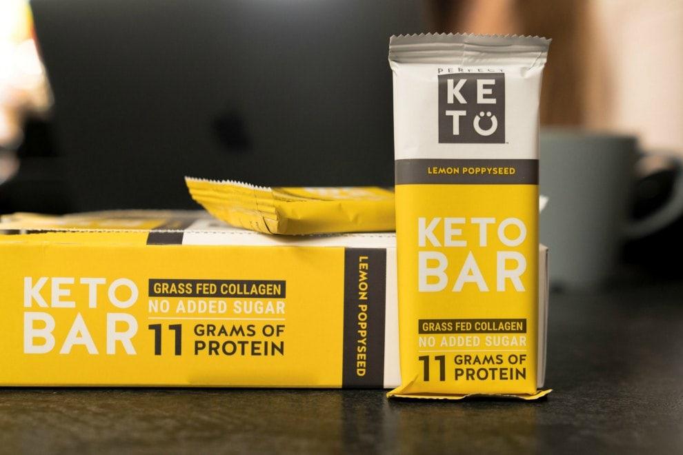 box containing 12 perfect keto bars review bars in lemon poppyseed