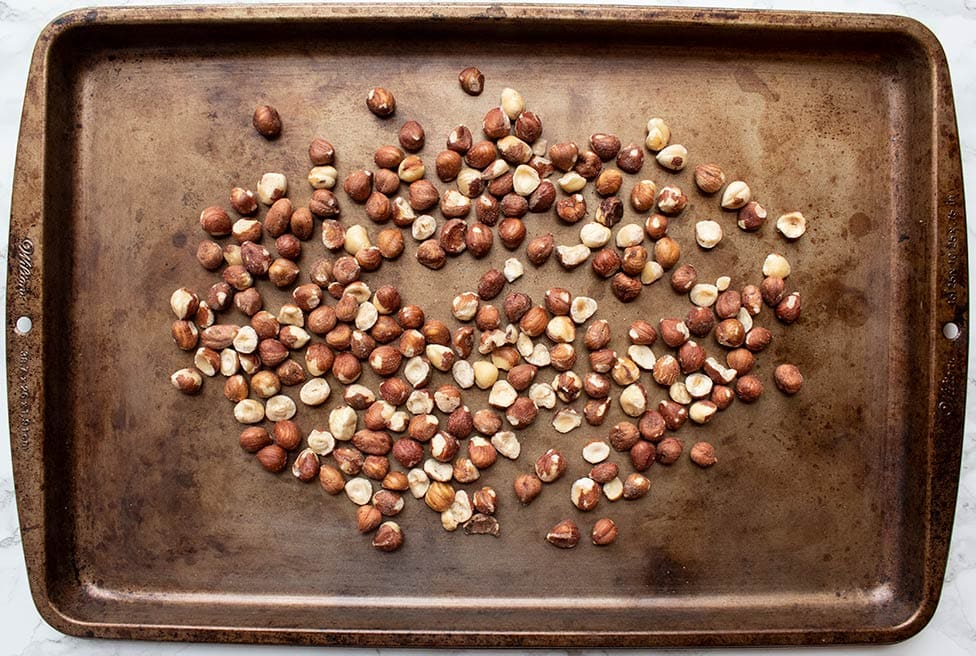 keto how to roast hazelnuts on a baking sheet with raw hazelnuts