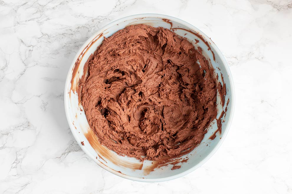 keto chocolate heaven mixed in a mixing bowl with chocolate ridges