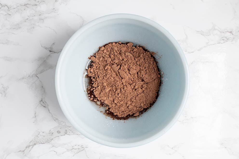 keto chocolate topping ingredients in a white bowl