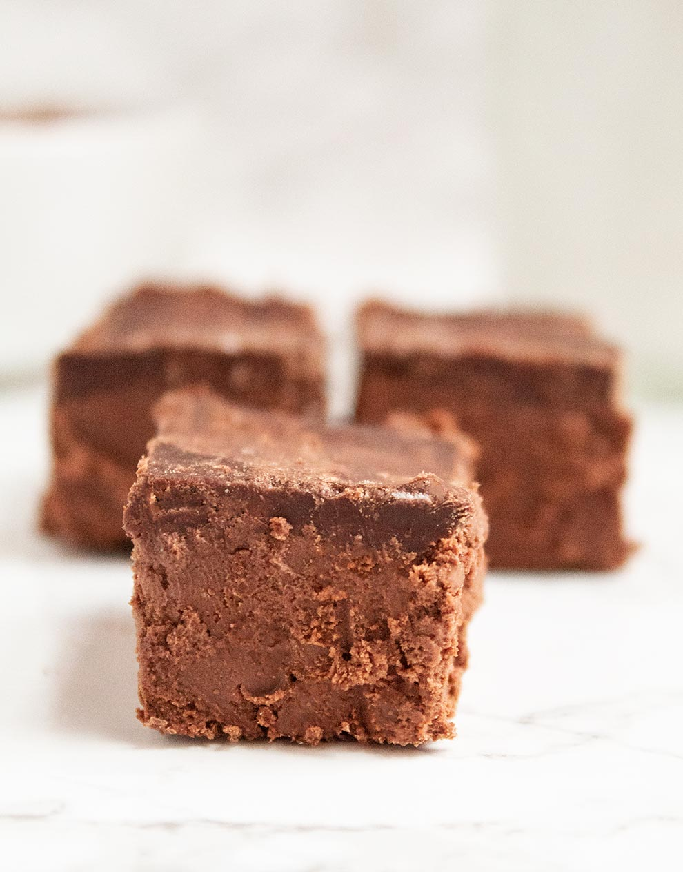 extremely close up shot of keto chocolate squares three pieces