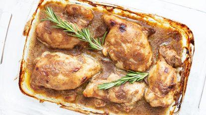 keto chicken thighs maple dijon sauce inside clear glass pan