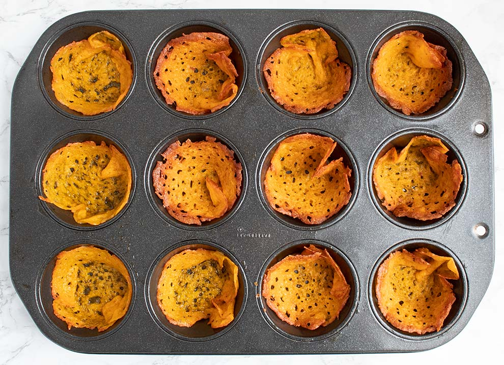 keto taco cups cheese placed inside the cupcake pan