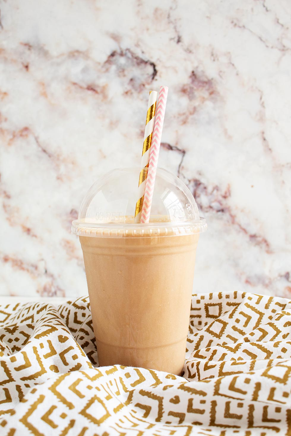 keto frappuccino copycat drink sitting on a gold and white decorative towel