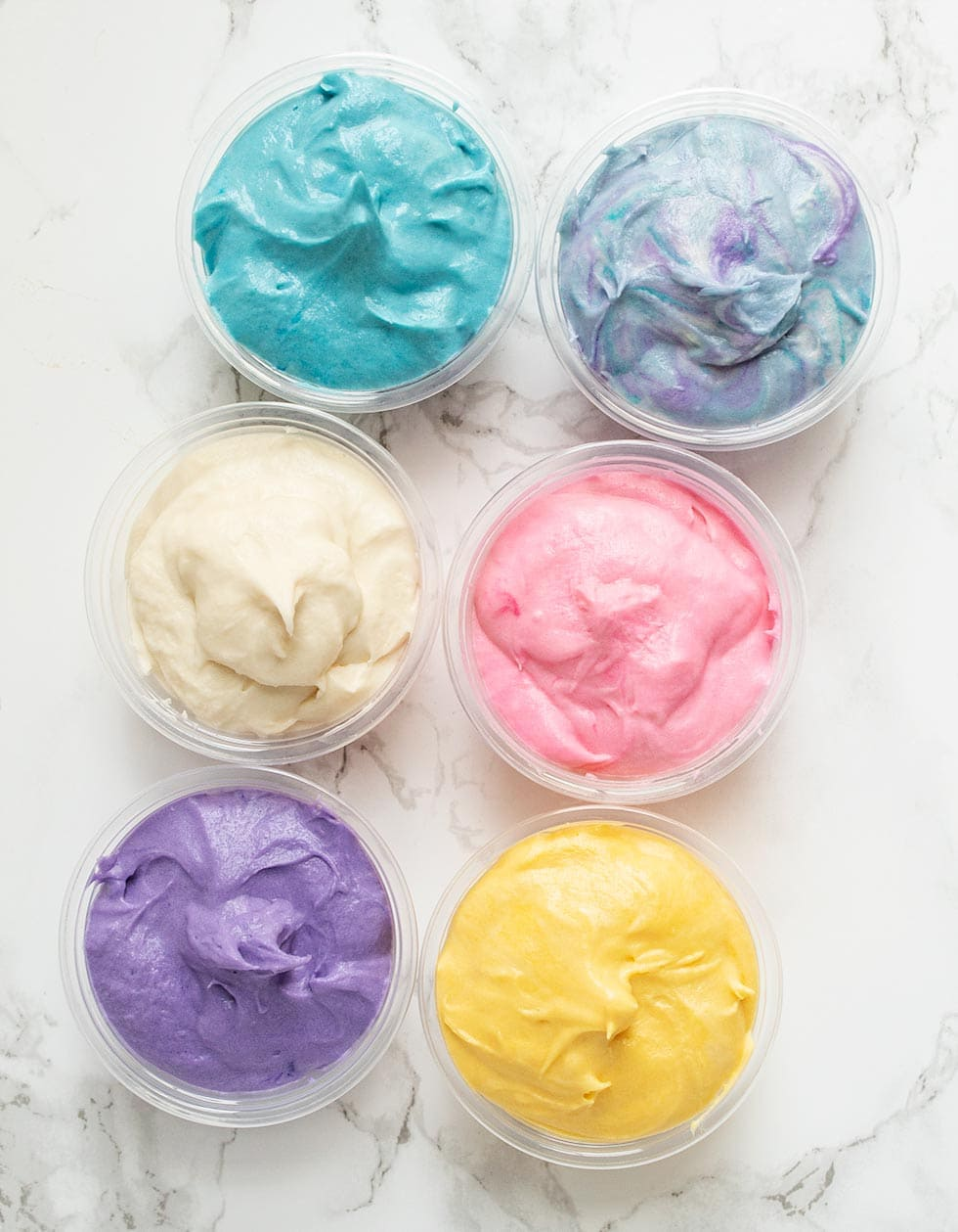 overhead view of keto frosting shots in various colors