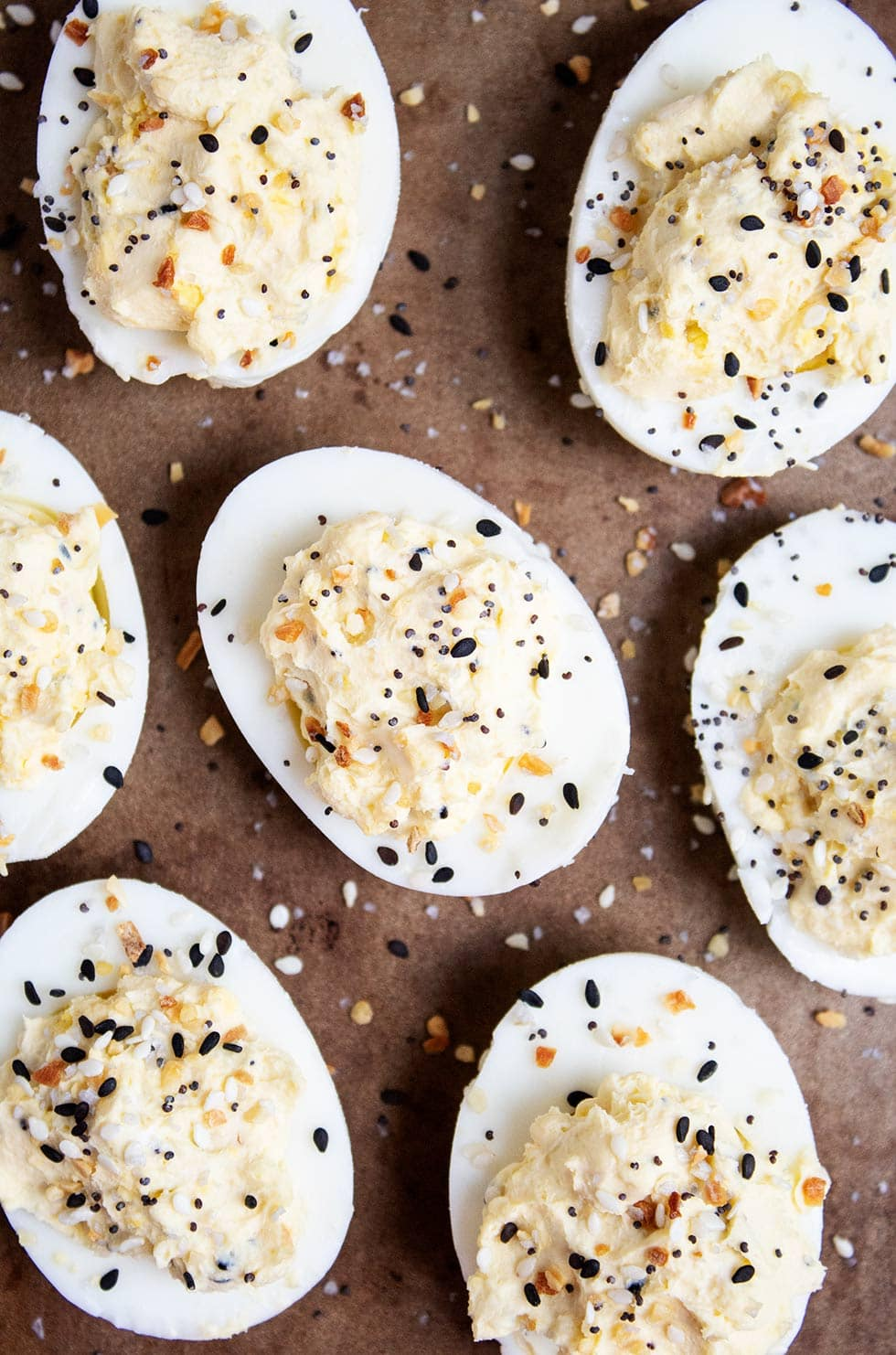 aerial view of keto deviled eggs cut in half and sprinkled with everything bagel seasoning