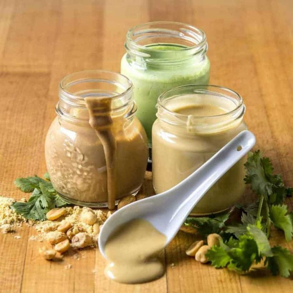 three jars of keto salad dressing