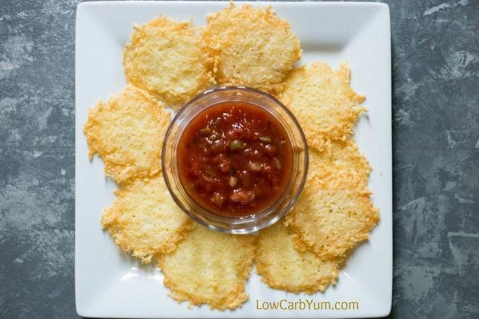 closeup of parmesan chips as a crunchy keto snack with salsa in the middle