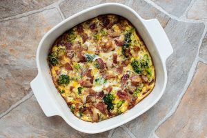 rotated white casserole dish containing cooked keto breakfast casserole