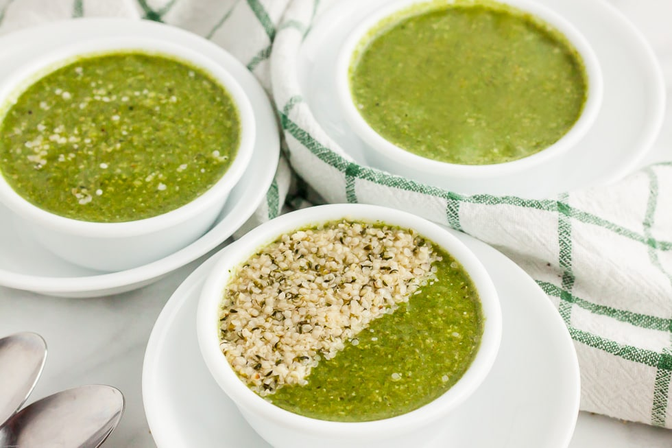 three bowls of keto flu soup with one bowl half covered in hemp seeds