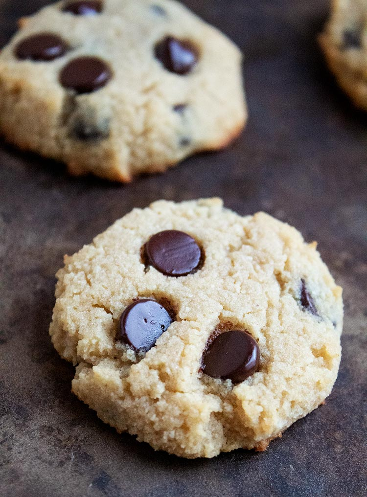 closeup of a keto chocolate chip cookie on a cookie sheet