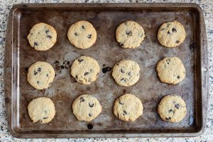 fully baked low carb chocolate chip cookies on a baking sheet