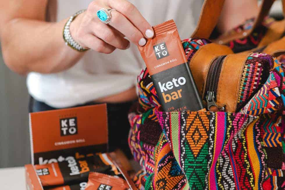 keto breakfasts without eggs showing a woman with a keto bar in her bag