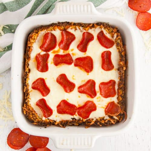 low carb pizza casserole in serving dish with pepperoni and cheese