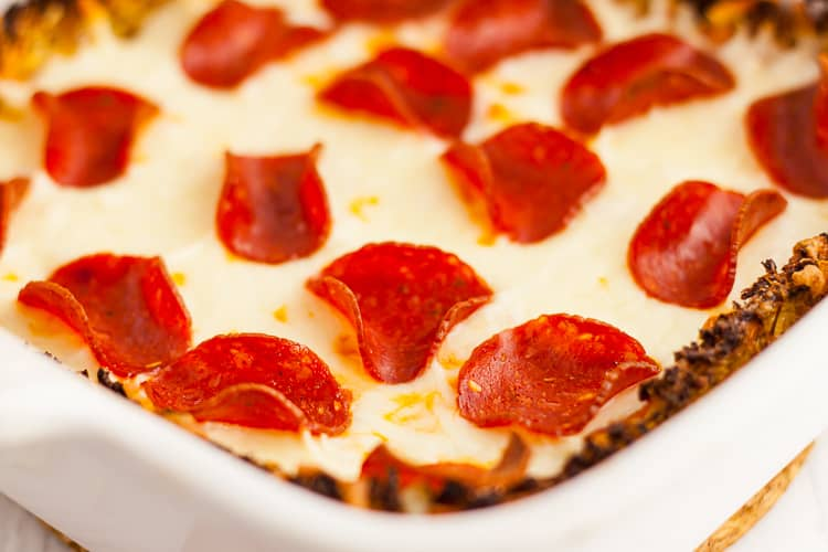 low carb crustless pizza in a baking dish with pepperoni and cheese