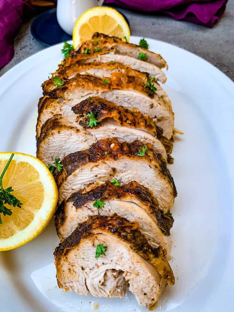 baked turkey slices no carb snacks on serving dish with slice of lemon