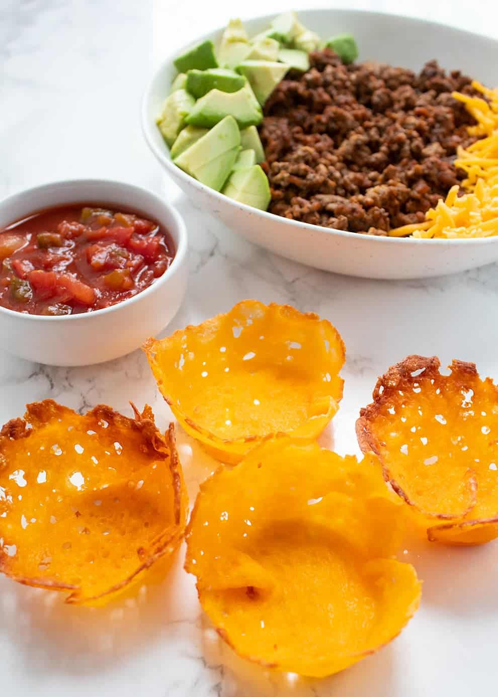 taco cups snacks with taco meat and salsa in bowl as no carb snacks