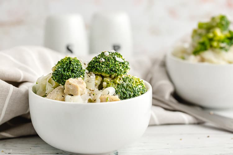 keto chicken alfredo and broccoli with noodles in serving bowl