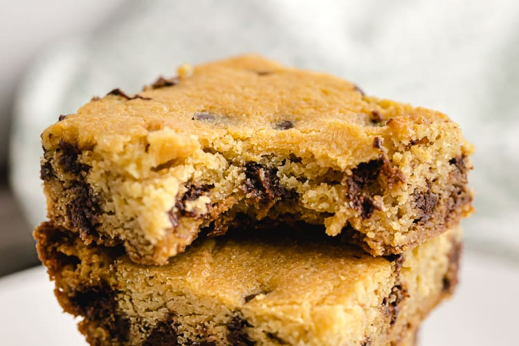 low carb chocolate chip cookie bars cut into squares and stacked on dish