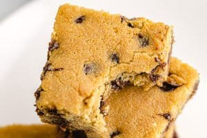 easy keto cookie bar squares on dish with chocolate chips