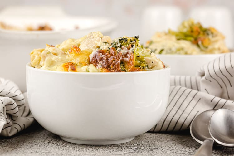 side view of individual portion of keto chicken broccoli casserole in a white bowl