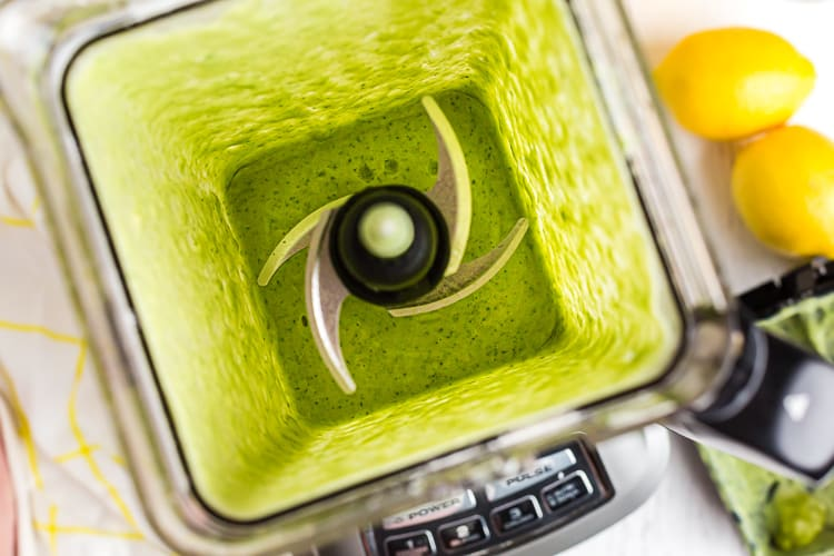 inside of blender with bright green keto smoothie inside