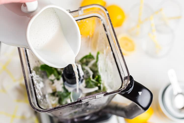 keto smoothie ingredients being poured into a blender