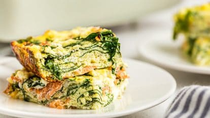side view of keto breakfast casserole with salmon pieces on a white dish